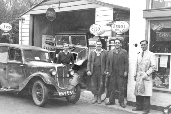The Garage with Harold Wadman and a Doubleday and Francis Van. Note the hand pumps!